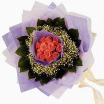 12 adet gül ve elyaflardan   Bolu çiçekçi mağazası